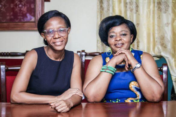 Brenda Stafford, left, and Anitta Kamara, right, of the Sierra Leone National Malaria Control Program.